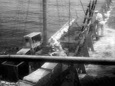 Parker is offloaded onto Moreau's boat